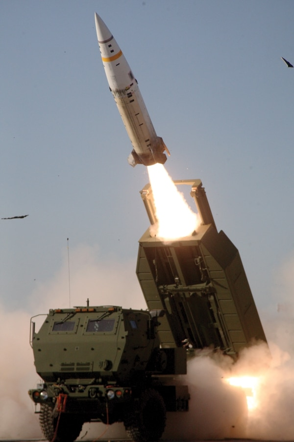 The M57A1 Army Tactical Missile System missile is fired over the cab of an M142 High Mobility Artillery Rocket System launcher. (Army)