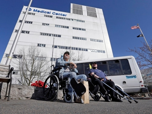 Veterans wait for their rides following treatment at the Veterans Affairs Puget Sound Medical Center in Seattle in March 2015. VA officials on Wednesday said an asset review set for 2022 could be moved up, to better gauge where medical facilities are needed. (Elaine Thompson/AP)