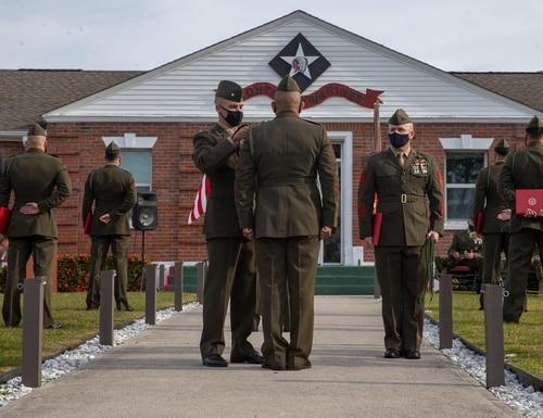 U.S. Marines and Sailors with 1st Battalion, 8th Marine Regiment (V18), 2d Marine Division, are awarded with the French Fourragere during a French Fourragere dedication ceremony on Camp Lejeune, North Carolina, Nov. 25, 2020. (photo by Lance Cpl. Jennifer E. Reyes, Marine Corps)