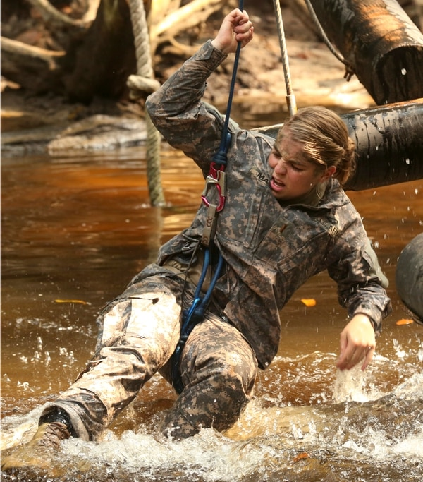 U.S. Army Paratrooper 2nd Lt. Gretchen Maty, assigned to 2nd Brigade Combat Team, 82nd Airborne Infantry Regiment, falls in the water during the obstacle course at the Jungle Warfare School in Gabon, June 14, 2016. Soldiers are attending the French Jungle Warfare School as part of U.S. Army Africa's exercise Central Accord 2016, an annual, combined, joint military exercise that brings together partner nations to practice and demonstrate proficiency in conducting peacekeeping operation. (U.S. Army photo by Sgt Henrique Luiz de Holleben/Released)