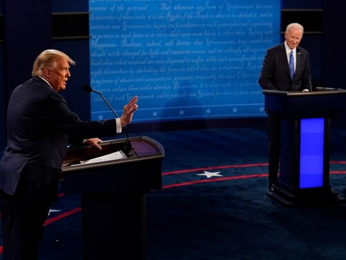 President Donald Trump answers a question as Democratic presidential candidate former Vice President Joe Biden listens during the second and final presidential debate at Belmont University on Oct. 22, 2020 in Nashville, Tenn. (Morry Gash-Pool/Getty Images)