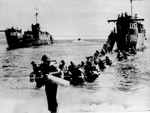 In this Aug. 16, 1944 file photo, American and allied troops wade up to an unidentified beach on the French Riviera. Carried out by French and American troops, the operation started on Aug. 15, 1944. France is paying tribute this week to Allied troops involved in landings on the Mediterranean coast. (AP)
