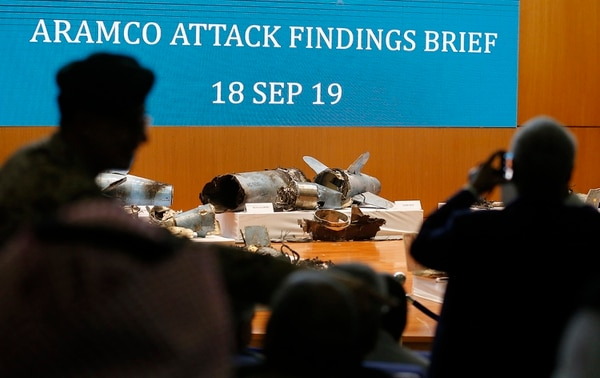 Journalists film what Saudi military spokesman Col. Turki al-Malki said was evidence of Iranian weaponry used in the attack targeted Saudi Aramco's facilities in Abqaiq and Khurais, during a press conference in Riyadh, Saudi Arabia, Wednesday, Sept. 18, 2019. (Amr Nabil/AP)