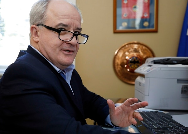 """Retired Air Force Maj. Gen. James Poss, speaks in his home office in Ocean Springs, Miss., on Jan. 17, 2018. Poss, whose Gmail was nearly compromised in a phishing attempt, said that military spying is now far easier than when somebody needed to carry blueprints or photographs out of office buildings. """"You'd need maybe 2,000 spies to do in the real world what a small group of cyberspies can do,"""" he says. (AP Photo/Rogelio V. Solis)"""