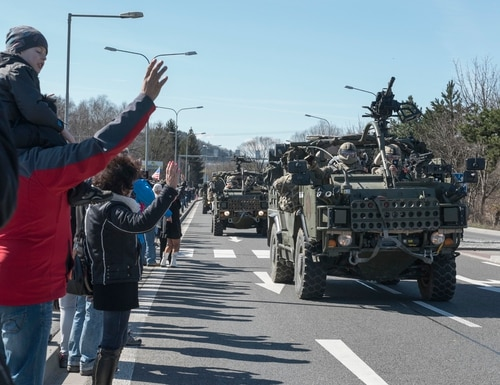 Polish citizens welcome 2nd Cavalry Regiment soldiers, along with British and Romanian troops as part of Battle Group Poland. (Sgt. 1st Class Patricia Deal/Army)