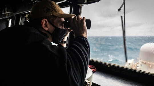 An American sailor scans the horizon as the guided-missile destroyer USS John S. McCain conducts operations at the Taiwan Strait, Dec. 30, 2020. (Mass Communication Specialist 2nd Class Markus Castaneda/U.S. Navy via AP)