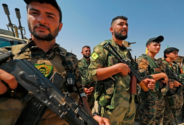 Members of the People's Protection Units (YPG), part of the of the Syrian Democratic Forces (SDF), gather in the town of Shadadi, Syria, on Sept. 11, 2018. (Delil Souleiman/AFP via Getty Images)