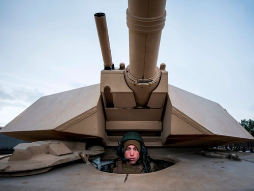 US Marines prepare their M1 Abrams tank to take part in an exercise to capture an airfield as part of the Trident Juncture 2018, a NATO-led military exercise, on Nov. 1, 2018. A new report warns that America is at risk of falling behind competitors. (Jonathan Nackstrand/AFP via Getty Images)