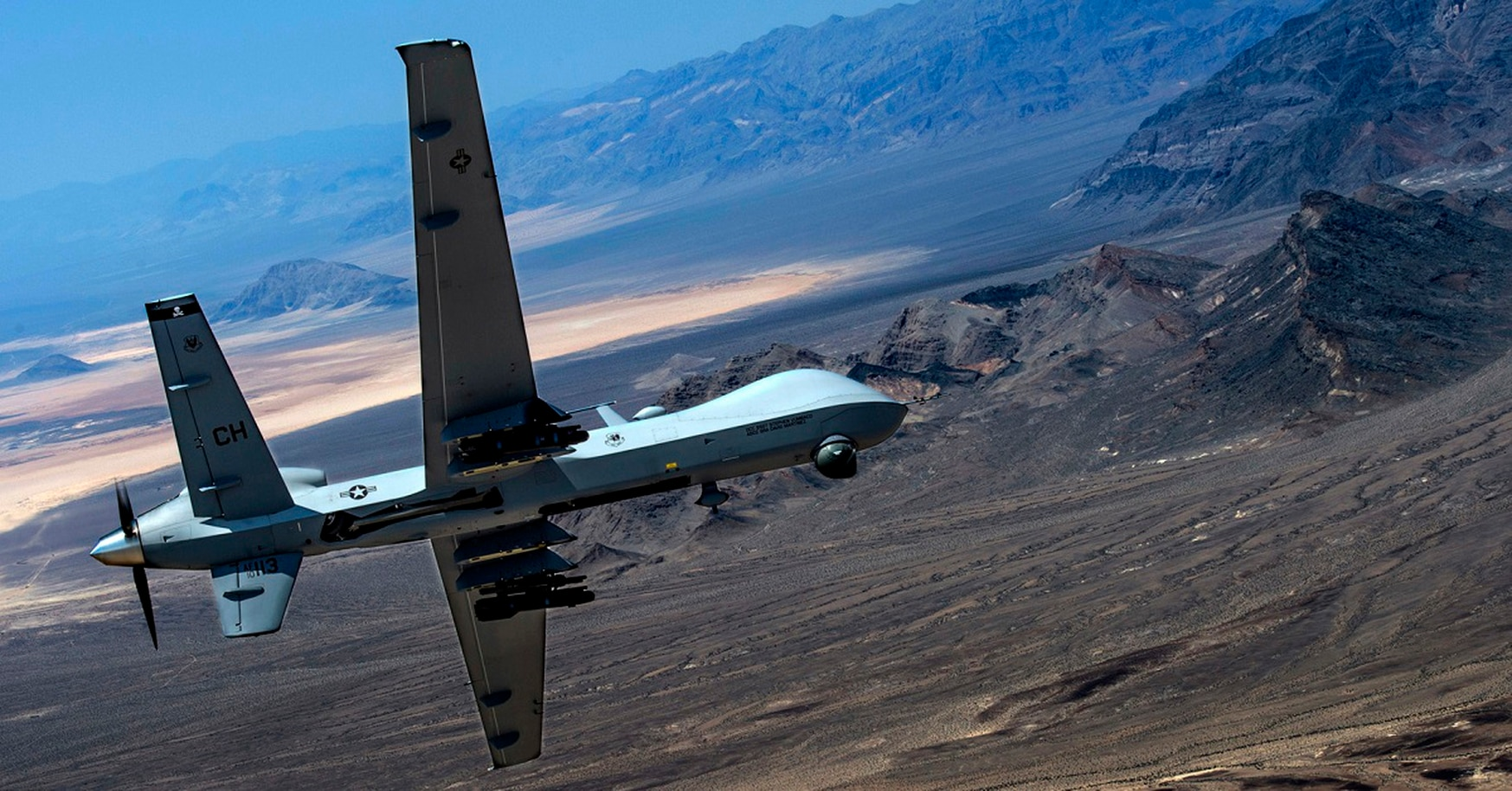 An MQ- Reaper remotely piloted aircraft performs aerial maneuvers over Creech Air Force Base, Nev., June 25, 2015. Such flights could be impacted if altimeters start to fail. (Senior Airman Cory D. Payne/U.S. Air Force)