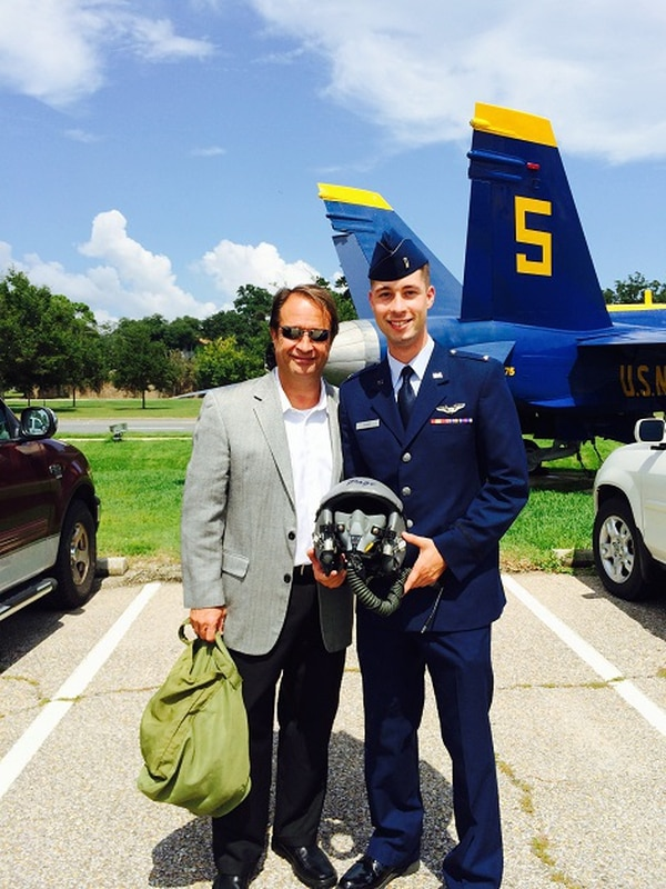 Stephen Page, left, with his son. Page has transitioned to civilian life, but has continued to find ways to serve veterans as a financial coach.