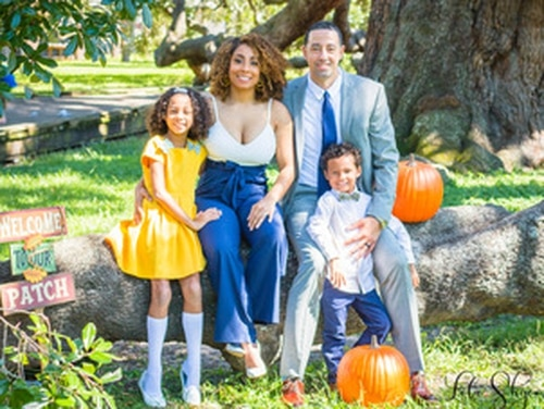 HM2 Ronald Rhea has chosen the new Blended Retirement System, weighing the choices carefully for the financial future of his family. Here he's pictured with wife Cheri, Kailei, 8 and Koi, 5. (Courtesy photo)