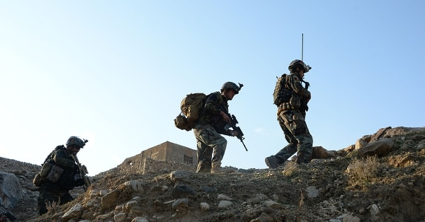 In this photograph taken on Jan. 3, 2018, Afghan Commandos forces patrol during ongoing U.S.-Afghan operation against Islamic State militants in Achin district of Nangarhar province. (Nooru,llah Shirzada/AFP/Getty Images)