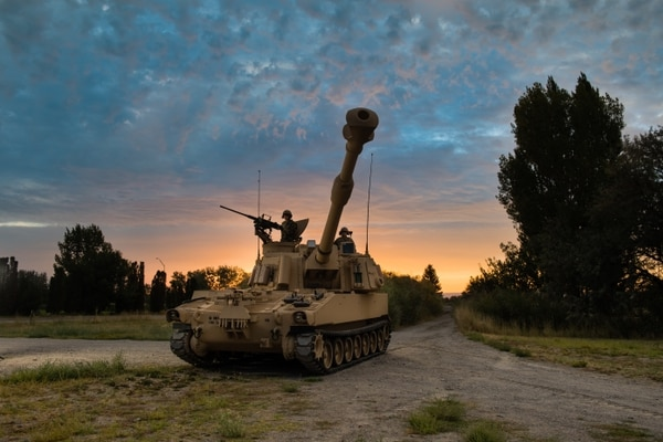 The M109A6 Paladin 155 mm Self-Propelled Howitzer, along with the M992A2 Field Artillery Ammunition Supply Vehicle, provide the primary indirect-fire support to armored brigade combat teams. (Army)