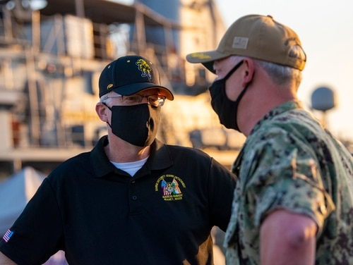 Acting Defense Secretary Christopher C. Miller meets with Navy Capt. Christopher Gilbertson, the commander of Task Force 55, during a visit to Naval Support Activity, Bahrain, Nov. 25, 2020. (Lisa Ferdinando/DoD)