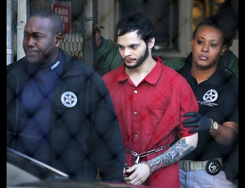 In this Jan. 30, 2017, file photo, Esteban Santiago, center, is led from the Broward County jail for an arraignment in federal court in Fort Lauderdale, Fla. Santiago, a 28-year-old Alaska man who pleaded guilty in the January 2017 Florida airport shooting that left five people dead and six wounded, will spend the rest of his life in prison. (Lynne Sladky/AP)