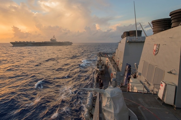 160713-N-WM647-195 SOUTH CHINA SEA (July 13, 2016) Sailors assigned to the Arleigh-Burke class guided-missile destroyer USS McCampbell (DDG 85), observe from the ship's weather decks as the Nimitz-class aircraft carrier USS Ronald Reagan (CVN 76) conducts routine flight operations. McCampbell is on patrol with the Carrier Strike Group Five (CSG 5) in the U.S. 7th Fleet area of responsibility supporting security and stability in the Indo-Asia-Pacific. (U.S. Navy photo by Mass Communication Specialist 3rd Class Elesia K. Patten/Released)