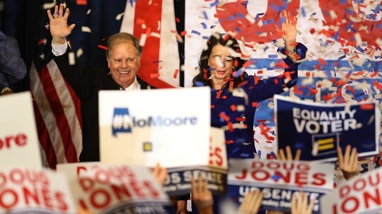 Doug Jones, left, democratic U.S. senator-elect, and wife Louise Jones greet supporters during his election night gathering at the Sheraton Hotel on Dec. 12, 2017, in Birmingham, Ala. (Justin Sullivan/Getty Images)