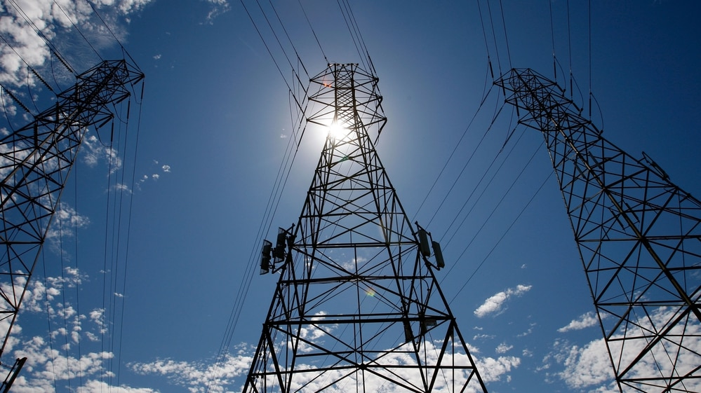 The sun shines over towers carrying electrical lines in South San Francisco, Calif.. A draft report issued by the U.S. president's National Infrastructure Advisory Council offers a series of recommendations for securing critical infrastructure from potential cyberattacks. (Justin Sullivan/Getty Images)
