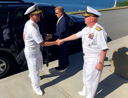 On June 12, 2018, Adm. John Richardson, left, chief of naval operations, greeted Rear Adm. Jeffrey Harley, president of the U.S. Naval War College in Newport, R.I. (Jennifer McDermott/AP)