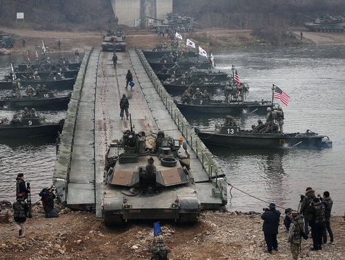 A U.S. M1A2 tank crosses a river during a U.S.-South Korea joint river crossing exercise in the border county of Yeoncheon, northeast of Seoul, on Dec. 10, 2015. The U.S. and South Korea remain at an impasse over how they share the cost of funding U.S. troops there. (Yonhap/AFP/Getty Images)