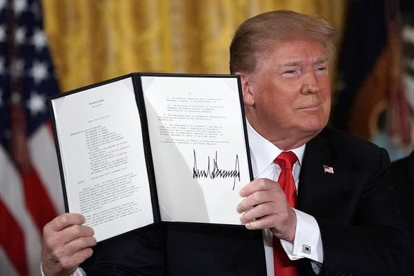 President Donald Trump holds up an executive order he signed June 18, during a meeting of the National Space Council, to establish the Space Force as the sixth branch of the U.S. armed forces. (Alex Wong/Getty Images)