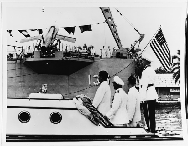 South Vietnam President Ngo Dinh Diem reviews the heavy cruiser Los Angeles in the Saigon River in late 1956. (U.S. Naval History and Heritage Command)