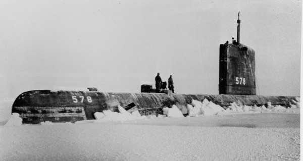 The submarine Skate surfaced at the North Pole on Apr. 1, 1959. The lead boat in her nuclear class, the Skate was the first sub to make a completely submerged trans-Atlantic crossing and the first to surface at the North Pole. (National Archives)