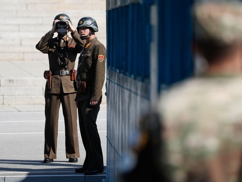 North Korean soldiers look at the South side at the truce village of Panmunjom in the Demilitarized Zone (DMZ) on Oct. 27, 2017. (Jeon Heon-Kyun/Getty Images)