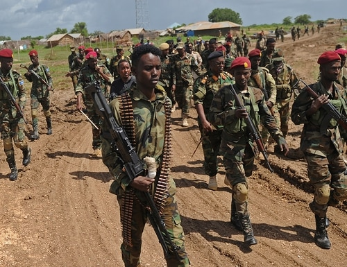Somali soldiers walk at Sanguuni military base, where an American special operations soldier was killed by a mortar attack on June 8, about 450 km south of Mogadishu, Somalia, on June 13, 2018. (Mohamed Abdiwahab/AFP via Getty Images)