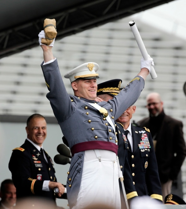 Class goat Alex Jordan Fletcher of Cosmopolis, Wash., graduating with the lowest grade point average, celebrates after receiving his diploma during a graduation and commissioning ceremony at the U.S. Military Academy on Saturday, May 21, 2016, in West Point, N.Y. (AP Photo/Mike Groll)