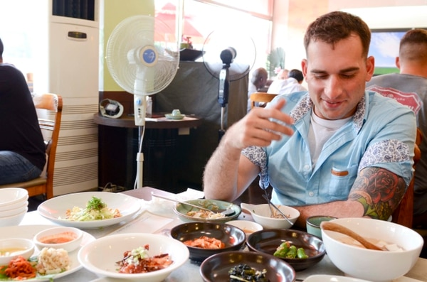 A Soldier from the 2nd Armored Brigade Combat Team, 1st Cavalry Division, dine on authentic Korean dishes at the Haneul Hyanggi Restaurant in Dongducheon, South Korea, during a tour organized by the Dongducheon City Council to expose Soldiers to Korean culture, Sept. 2, 2015. (U.S. Army photo by Staff Sgt. John Healy, 2ABCT, 1CAV)