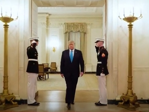 Two uniformed Marines salute President Donald Trump as he walks through the White House in a video clip featured during the Republican Convention on Aug. 25, 2020. (Screengrab courtesy of the Republican National Committee)