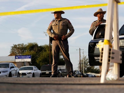Law enforcement officials work the scene of a shooting at the First Baptist Church of Sutherland Springs, Monday, Nov. 6, 2017, in Sutherland Springs, Texas. (Eric Gay/AP)