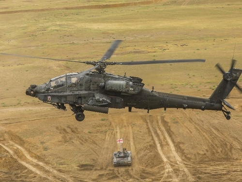 An AH-64 Apache helicopter flies over Georgian Armed Forces T-72 tanks and 2nd Cavalry Regiment's Stryker mobile gun system at the Noble Partner 18 live fire exercise in Vaziani, Georgia, Aug. 15, 2018. On Tuesday, Senate lawmakers advanced plans for $674 billion in defense appropriations for fiscal 2019 as part of a larger spending measure. (1st Lt. Ellen C. Brabo/Army)