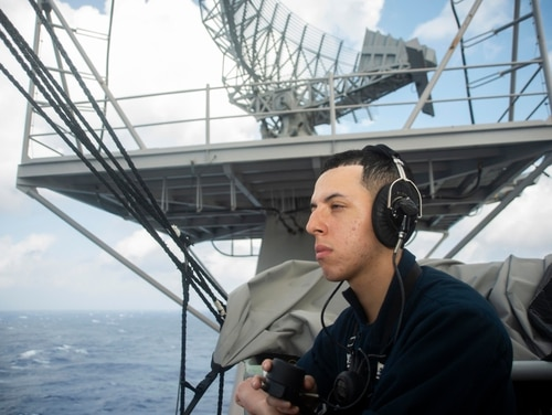 Operations Specialist Seaman Ronaldo Marque stands watch aboard the aircraft carrier Dwight D. Eisenhower on Friday. Ike's slated to return to its homeport Saturday evening. (Mass Communication Specialist 3rd Class Samuel Lee Pederson/Navy)