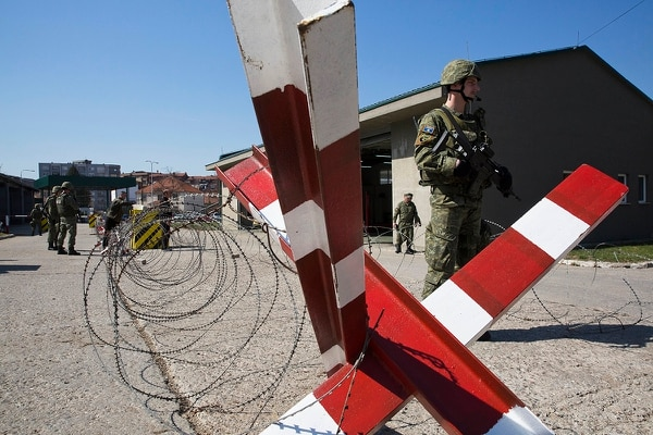 In this photo taken March 22, 2018, member of Kosovo Security Force man a checkpoint during an exercise inside the barracks in the southern part of the ethnically divided town of Mitrovica. (Visar Kryeziu/AP)