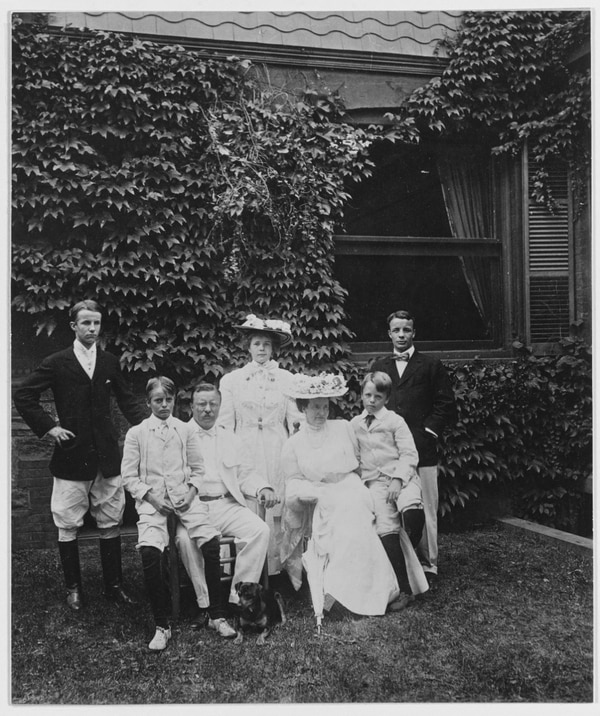 Then-Assistant Secretary of the Navy Theodore Roosevelt poses during an Aug. 21, 1897 family portrait, probably taken at Sagamore Hill, Oyster Bay, Long Island. From left to right: Kermit, Archibald, TR, Ethel, Edith Kermit Carow Roosevelt, Quentin and Theodore Roosevelt. (U.S. Naval History and Heritage Command)