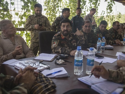 U.S. service members attend a meeting with Afghan National Defense and Security Forces leaders near Nawa district in Helmand province, Afghanistan, Aug. 31, 2017. Defense Secretary Jim Mattis signed orders over the last week to deploy about 3,500 additional forces to Afghanistan. (Sgt. Justin T. Updegraff/Marine Corps)