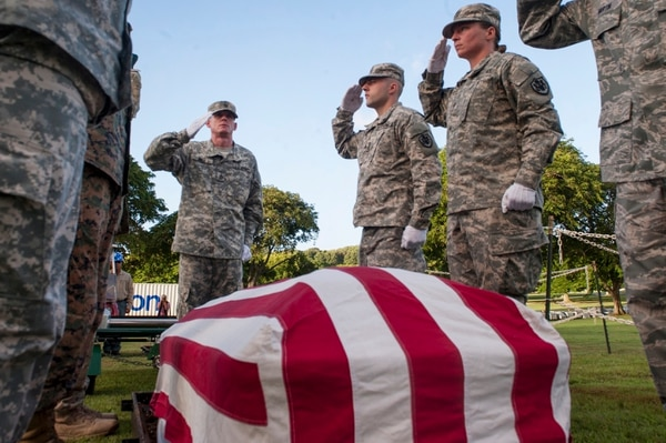 Defense POW/MIA Accounting Agency honor guard members perform a dignified transfer for unknown service members from the battleship Oklahoma on Nov. 9, 2015, at the National Memorial Cemetery of the Pacific in Honolulu. (Air Force)