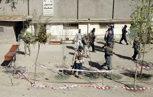 Security forces patrol after a bomb explosion near a polling station in Kabul, Afghanistan, Saturday, Oct. 20. Tens of thousands of Afghan forces fanned out across the country as voting began Saturday in parliamentary elections that followed a campaign marred by relentless violence. (Massoud Hossaini/AP)