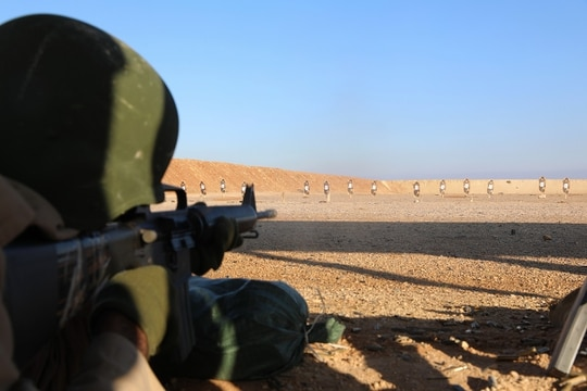 An Iraqi soldier aims during qualification on the 100-meter target on the range at Camp Al Asad in Iraq on Feb. 19, 2018. The work was part of training with American and other foreign troops in fighting terrorist cells throughout the Middle East. On Tuesday, a pair of U.S. lawmakers said they worry Congress has not had enough oversight on those type of missions. (Spc. Zakia Gray/Army)