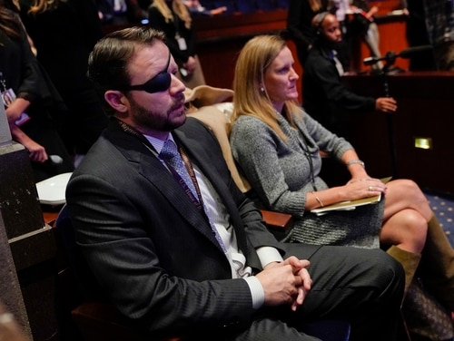 Rep. Dan Crenshaw, R-Texas, left, listens during member-elect orientations on Capitol Hill in Washington in December 2017. (Pablo Martinez Monsivais/AP)