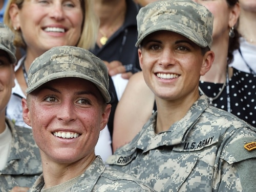 In August 2015, 1st Lt. Shaye Haver, center, and Capt. Kristen Griest, right, are shown with other West Point alumni after an Army Ranger school graduation ceremony at Fort Benning, Georgia. Haver and Griest became the first female graduates of the Army's rigorous Ranger School. Now they tell what it has been like to be among the first women in the U.S. infantry. (John Bazemore/Associated Press)