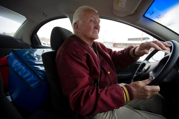 In this Thursday, Dec. 21, 2017 photo, Meals on Wheels Volunteer Elmer Hoke, 92, drives his Meals on Wheels delivery route in Casper, Wyo. He drives every weekday and logs the most days a year among the volunteers. (Josh Galemore/The Casper Star-Tribune via AP)