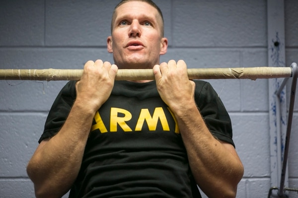 Sergeant Major of the Army Dan Dailey works out with Staff Sgt. Joseph Fontenot, Military Times Soldier of the Year, at the fitness center on Fort Myer, VA, on Tuesday, July 21, 2015.