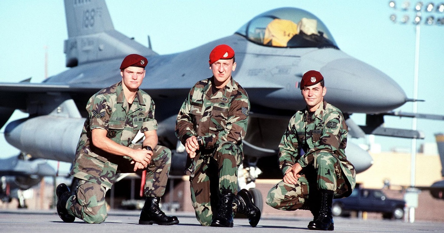 In 2000, a year after the rescue, Senior Airman Ron Ellis, from left, and Staff Sgts. Andy Kubik and Jeremy Hardy posed in front of an F-16 Fighting Falcon at Hurlburt Field, Florida. (Airman Magazine)
