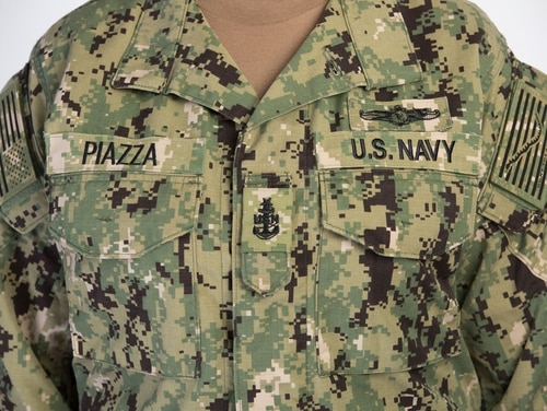 The front of the NWU Type III blouse showing the proper wear of name tapes, rank and warfare insignia as well as the shoulder patches. (Alan Lessig/Staff)