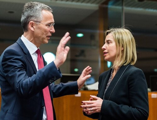 NATO Secretary General Jens Stoltenberg, left, speaks with European Union High Representative Federica Mogherini during a meeting at the European Council building in Brussels. The EU's Federica Mogherini said the official calendar for the summer of 2016 provides good synergy for forging a better working relationship between NATO and the EU. (AP Photo/Geert Vanden Wijngaert)