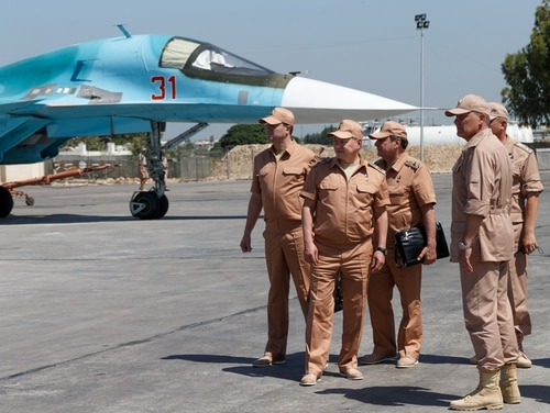 Russian Defense Minister Sergei Shoigu, second left, visits the Hemeimeem air base in Syria, Saturday, June 18, 2016. Russia's defense minister visited Syria on Saturday to meet the country's leader and inspect the Russian air base there, a high-profile trip intended to underline Moscow's role in the region. (Vadim Savitsky/Russian Defense Ministry Press Service pool photo via AP)