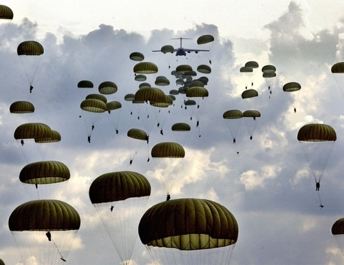 Paratroopers of the Army's 82nd Airborne Division drop into Fort Bragg's Sicily Drop Zone on Oct. 7, 2003. (David Smith/The Fayetteville Observer/AP)